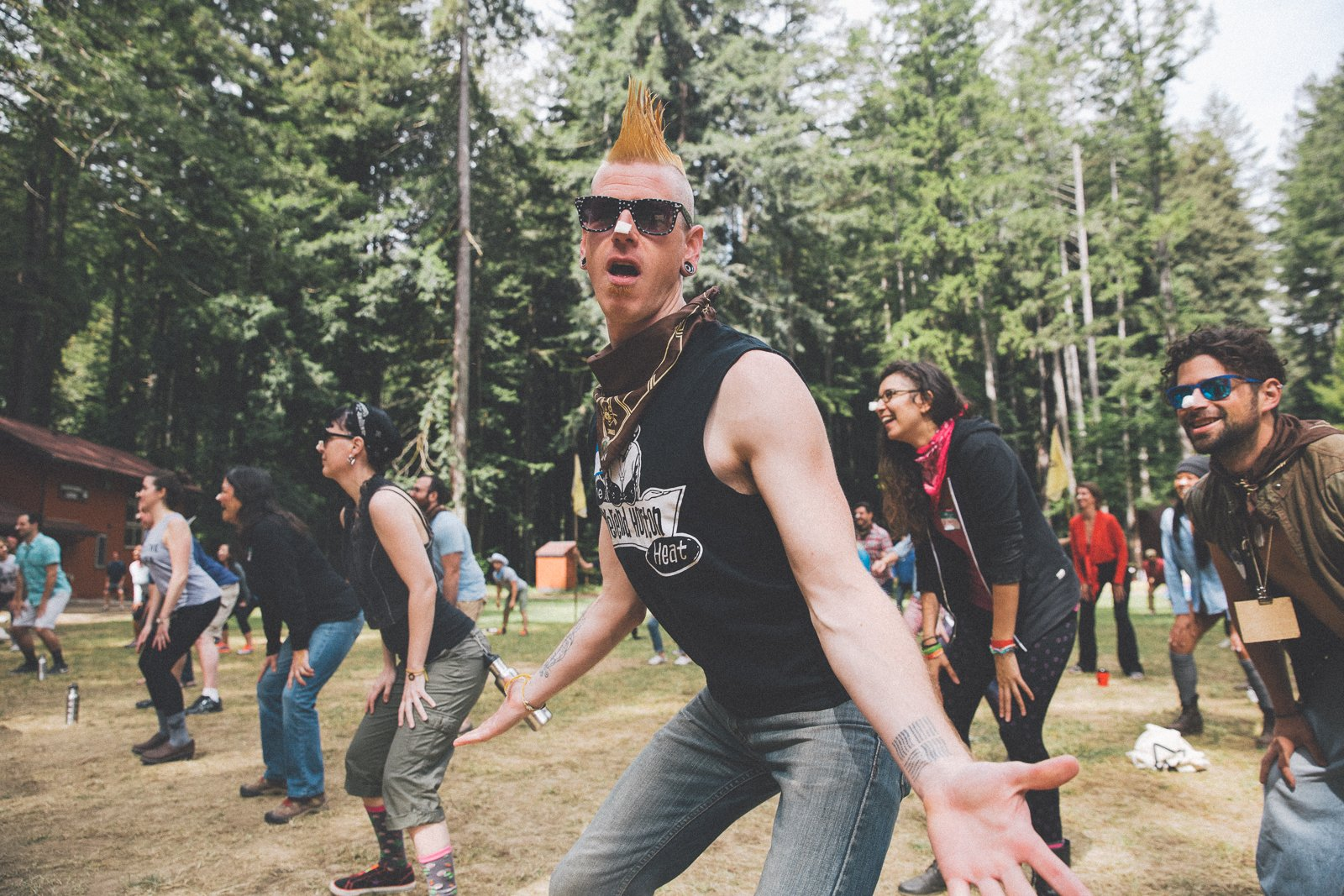 Camper with a yellow mohawk participating in a group activity